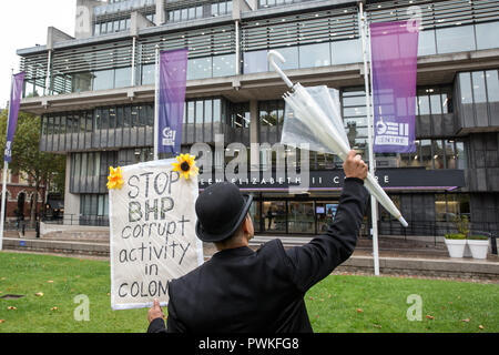 London, UK. 17th October, 2018. A human rights defender protests outside the AGM of BHP, the world's largest mining company, as part of a demonstration by the Gaia Foundation, London Mining Network and War on Want against the impact of the multinational's mining projects on communities in Latin America. Environmental human rights defenders from Colombia, Chile and Brazil were present at the demonstration and annual general meeting. Credit: Mark Kerrison/Alamy Live News Stock Photo