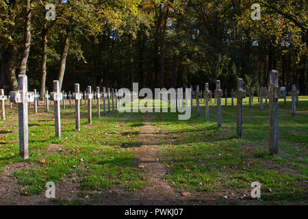 Rows of identical headstone stone crosses on graveyard - Stock Photo