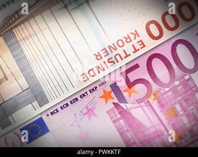 Two money bills aligned and setup next to each other symbolizing exchange business concepts. - Stock Photo
