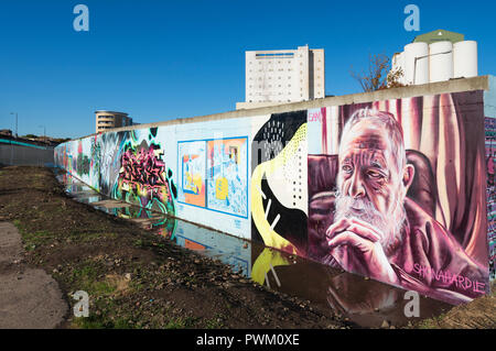 View of murals painted on wall at Marine Parade Graffiti Wall in Leith , Scotland, - Stock Photo