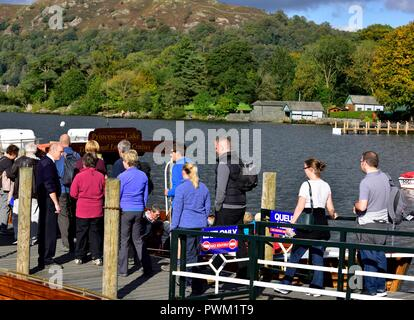 Waterhead boat jetty,tourists boarding a boat trip on lake windermere,Ambleside,Lake district,Cumbria,England,UK - Stock Photo