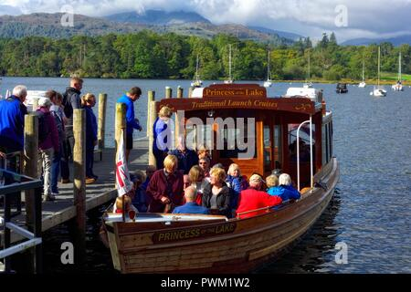 Waterhead boat jetty,tourists boarding princess of the lake for a boat trip on lake windermere,Ambleside,Lake district,Cumbria,England,UK - Stock Photo