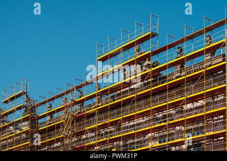 facade restoration, under construction - scaffolding on historic building - Stock Photo