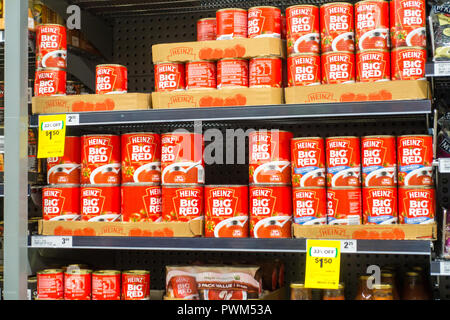 Cans of Heinz Big Red Tomato Soup on Woolworths supermarket shelves, Tamworth NSW Australia. - Stock Photo