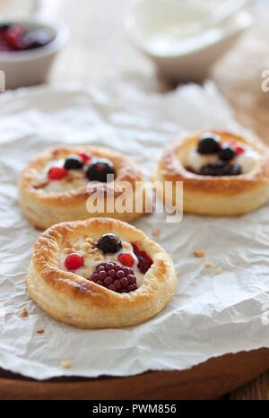 Puff pastry tartlets with a berries and a vanilla and quark filling - Stock Photo