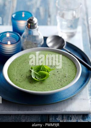 Cream of spinach and sage soup with basil - Stock Photo