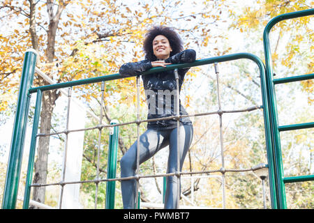 Attractive Sporty Young Woman At Outdoor Fitness Park