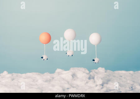 Three sheep playing above the clouds - Stock Photo