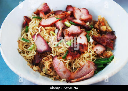 Egg noodle  with red roast pork - Stock Photo