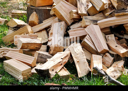 A pile of chopped firewood logs ready for the winter. Cut logs fire wood. Hardwood, wood and lumber industry. Heating season, winter season. Renewable - Stock Photo