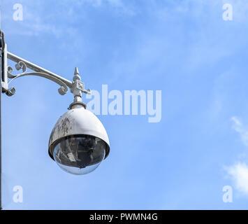 A circuit camera mounted on an ornate bracket. - Stock Photo
