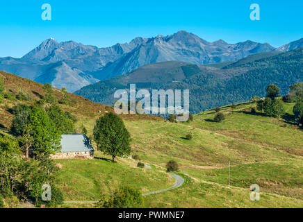 France, Pyrenees National Park, Occitanie region, Val d'Azun, road of the col de Couraduque (mountain pass), mountain pasture meadows, Pan ridge and Pic d'Arrouy in the background (1,522 meters) - Stock Photo