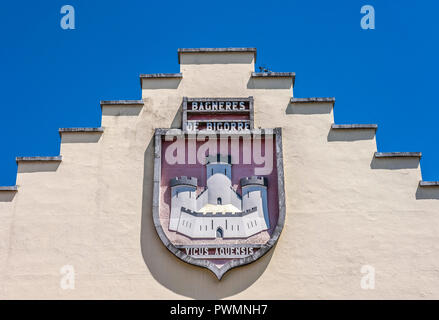 France, Occitanie region, Hautes-Pyrenees, spa town of Bagneres-de-Bigorre, coat of arms of the town on the post office pediment - Stock Photo
