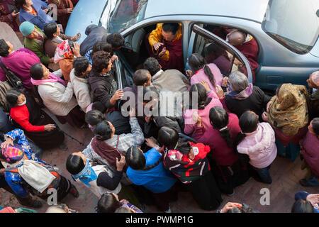 Pilgrim crowd wishing to approach Lama Karma at Bodnath Monastery, Kathmandu, Nepal - Stock Photo