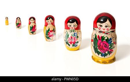 A growing row of Matrjoschka on white background - Stock Photo