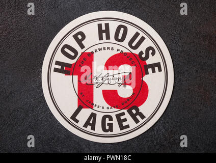 LONDON, UK - AUGUST 22, 2018: 13 Hop House Lager paper beer beermat coaster on black background. - Stock Photo