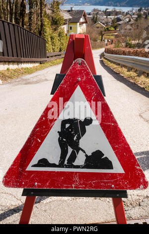 Traffic warning sign Road construction works on a street of austrian town - Stock Photo
