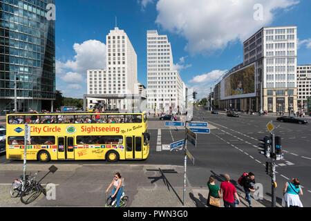 Berlin. Germany. Yellow City Circle Sightseeing bus on Potsdamer Platz. Elevated view. - Stock Photo