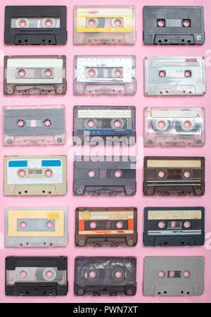 Vintage Still Life. Set of old cassettes on a light pink surface View from above. - Stock Photo