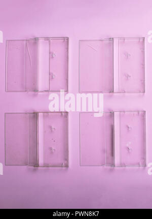 Vintage Still Life. Set of old cassettes covers on a light pink surface View from above. - Stock Photo