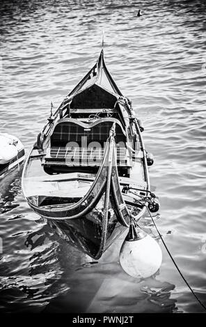 Historical gondola in harbor, Split, Croatia. Summer vacation. Travel destination. Black and white photo. - Stock Photo