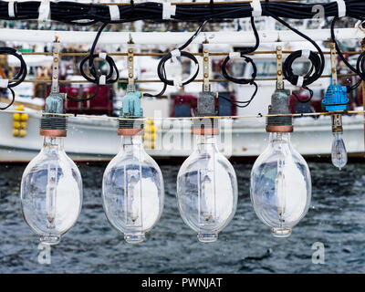 Squid Fishing Boat lights Hakodate Japan - powerful lights on board Japanese Squid fishing boats attract squid to the surface at night - Stock Photo