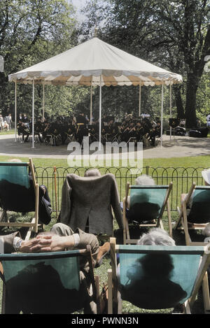 Royal Corps of Transport Concert Band playing at St James Park Bandstand, London, England, UK> Circa 1980's - Stock Photo