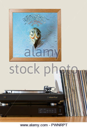Record player and framed album cover, Eagles Their Greatest Hits, England - Stock Photo