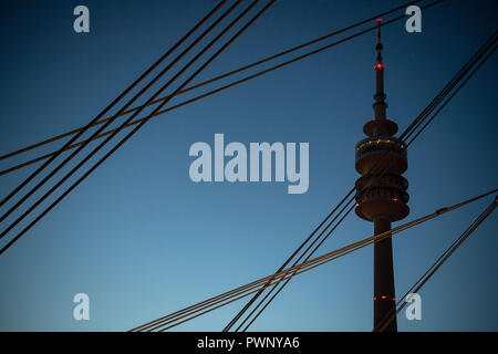 Munich, Bavaria. 17th Oct, 2018. The Olympic Tower can be seen behind the tension cables of the Olympic Hall. Credit: Lino Mirgeler/dpa/Alamy Live News - Stock Photo