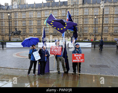Westminster, London, UK. 17th Oct 2018. People protest against Brexit outside the Houses of Parliament on the day when British Prime Minister Theresa May goes to Brussels to have more talks about Britain leaving the EU. Brexit, Westminster, London, on October 17, 2018. Credit: Paul Marriott/Alamy Live News Stock Photo