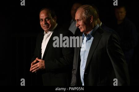 Russian President Vladimir Putin walks with Egyptian President Abdel Fattah el-Sisi, left, for an Informal meeting while taking an evening out around the city October 16, 2018 in Sochi, Russia. - Stock Photo