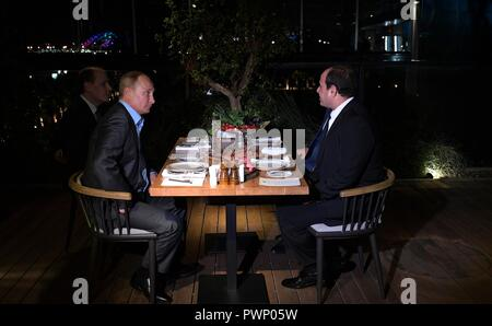 Russian President Vladimir Putin and Egyptian President Abdel Fattah el-Sisi, right, hold an Informal meeting at an outdoor restaurant October 16, 2018 in Sochi, Russia. - Stock Photo