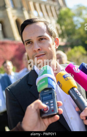 Munich, Bavaria. 17th Oct, 2018. Martin Hagen, chairman of the FDP state parliamentary group, gives an interview to the Bavarian state parliament. The new FDP state parliamentary faction has elected Hagen, who had also led the FDP as the leading candidate in the state elections, as its chairman. Credit: Matthias Balk/dpa/Alamy Live News - Stock Photo