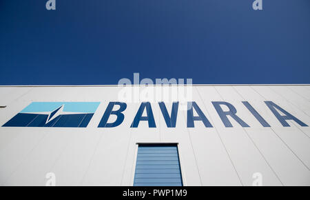 Giebelstadt, Bavaria. 17th Oct, 2018. The logo of the Bavarian boat builder Bavaria Yachtbau stands at a production hall of the company. Credit: Daniel Karmann/dpa/Alamy Live News - Stock Photo