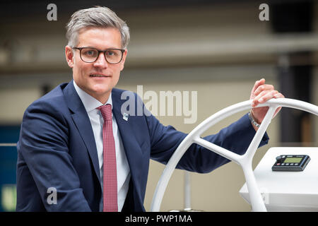 Giebelstadt, Bavaria. 17th Oct, 2018. Ralph Kudla, managing director for restructuring at the Bavarian boat builder Bavaria Yachtbau, sits on a boat in production. Credit: Daniel Karmann/dpa/Alamy Live News - Stock Photo
