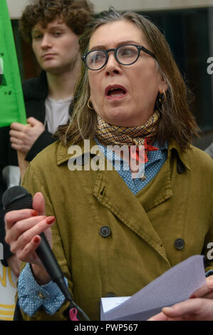 London, UK. 17th October 2018. Beverley, a home owner from Green Quarter Manchester, speaks at the protest outside the Ministry of Housing, Communities and Local Government by residents living in tower blocks covered in Grenfell-style cladding, Fuel Poverty Action, and Grenfell campaigners demanding that the government make all tower-block homes safe and warm. Credit: Peter Marshall/Alamy Live News - Stock Photo