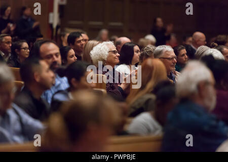 """Seattle, Washington DC, USA. 17th Oct 2018. Supporters cheer for Attorney General Bob Ferguson during a discussion on the current state immigration. """"Immigration Reform in Washington State"""" was hosted by St. Mark's Episcopal Cathedral and included a panel with representatives from Casa Latina, El Centro de la Raza and the Church Council of Greater Seattle. Credit: Paul Christian Gordon/Alamy Live News - Stock Photo"""