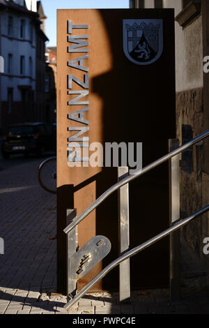 Worms, Germany - October 13, 2018: A rusted stele of the tax office Worms at the entrance stairs of the finance and office building on October 13, 201 - Stock Photo