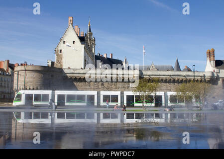 France, Nantes, tram going in front of the Castle (Chateau des Ducs). - Stock Photo