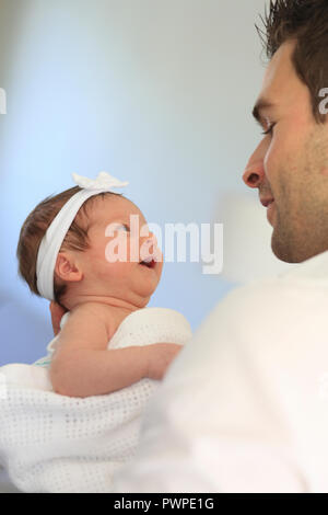 Baby with father at home - Stock Photo