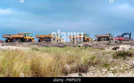 France, Gironde, Medoc bleu (campsite), Soulac-sur-mer, trucks to cover with sand the dunes threatened by marine submersion - Stock Photo
