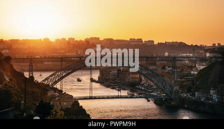 Aerial view of Porto with Douro river and famous view of Dom Luis I Bridge in skyline at sunset, Portugal - Stock Photo