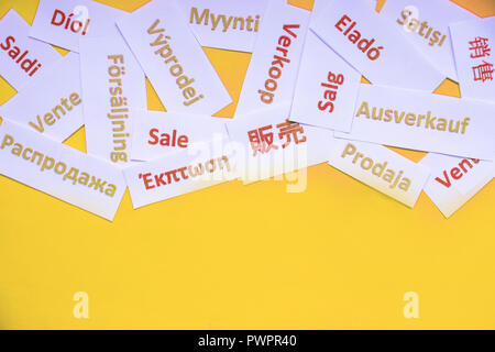 Sale sign isolated on yellow background. Black friday concept in all over the world. clothing,technic, store window, Sale sign on different languages ,shopping discount concept.Copy space - Stock Photo