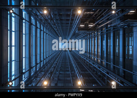 View looking up from under an elevator shaft in the Blue Cross Blue Shield building 300 E Randolph in downtown Chicago - Stock Photo