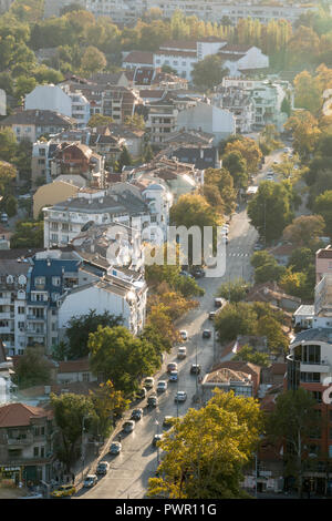 Autumn leaf fall in tree lined street of Plovdiv, Bulgaria - Stock Photo
