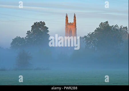 Rural village church tower on a misty autumnal morning at Hampton Lucy, Warwickshire - Stock Photo