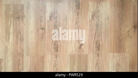 Brown wood laminate floor varnish interior in modern home design. Wooden parquet background, Wood texture for design and decoration - Stock Photo