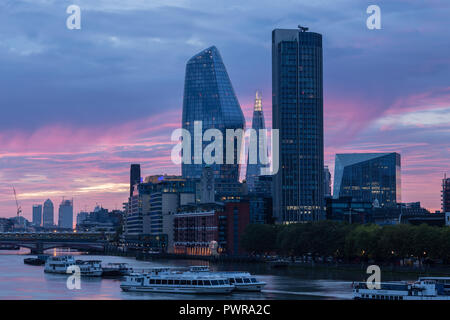 Sunrise over the river Thames at London from Waterloo bridge, with the shard, south bank tower, the vase, and the walkie talkie skyscrapers - Stock Photo