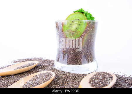 healthy drink in glass with chia seeds, kiwi and lemon juice on white background - Stock Photo