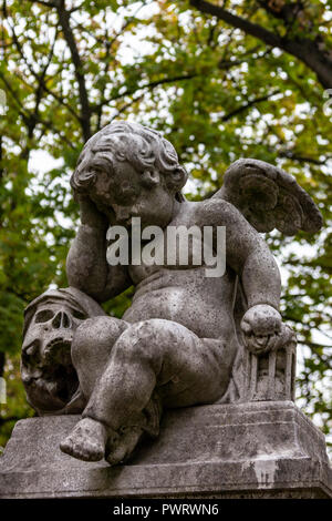 Angel & Death - Pere Lachaise Cemetery is the largest cemetery in Paris and is notable for the final resting place for many celebrities, artists, writ - Stock Photo
